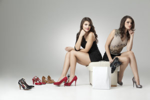 two women with fashion shoes